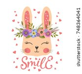 Stock vector cute bunny with floral wreath 748364041