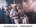 happy people drinking champagne ... | Shutterstock . vector #748366819