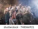 happy group of people clinking... | Shutterstock . vector #748366921