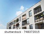 modern apartment buildings on a ... | Shutterstock . vector #748372015