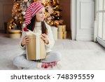 adorable female child wears... | Shutterstock . vector #748395559