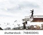 businessman walking blindfolded ... | Shutterstock . vector #748403041