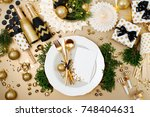 christmas table setting with... | Shutterstock . vector #748404631