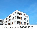 modern apartment buildings on a ... | Shutterstock . vector #748415329