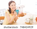 young attractive asian woman... | Shutterstock . vector #748424929