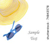 Yellow hat with blue sunglasses perfect for a summer day at the beach.  Isolated on white with a clipping path. - stock photo