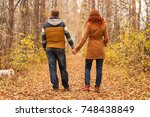couple holding hands and... | Shutterstock . vector #748438849