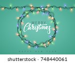 glowing christmas lights wreath ... | Shutterstock . vector #748440061