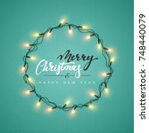 glowing christmas lights wreath ... | Shutterstock . vector #748440079