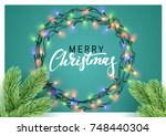 christmas glowing lights.... | Shutterstock . vector #748440304