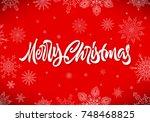 merry christmas calligraphic... | Shutterstock . vector #748468825