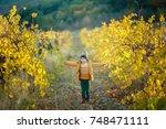 cute little boy in a yellow...   Shutterstock . vector #748471111