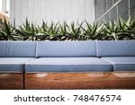 roof top bar with blue cushions ... | Shutterstock . vector #748476574