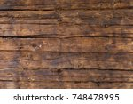 an old wooden house in the... | Shutterstock . vector #748478995