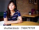 beautiful girl is waiting... | Shutterstock . vector #748479709