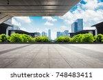 modern buildings at riverbank | Shutterstock . vector #748483411