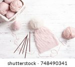 pink coil of yarn in the basket ... | Shutterstock . vector #748490341