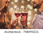 beautiful young couple is... | Shutterstock . vector #748493221