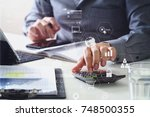 businessman hand working with... | Shutterstock . vector #748500355