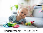 cute baby boy  playing with... | Shutterstock . vector #748510321
