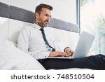 handsome businessman using...   Shutterstock . vector #748510504