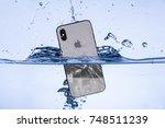 iphone x in water  2017 11 05... | Shutterstock . vector #748511239