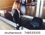 young businesswoman getting her ... | Shutterstock . vector #748535335