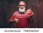 Senior Bearded Man Holding Gif...