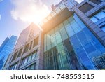 skyscrapers from a low angle... | Shutterstock . vector #748553515