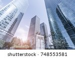 skyscrapers from a low angle... | Shutterstock . vector #748553581