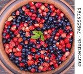 colorful mixed berries fruit.... | Shutterstock . vector #748559761