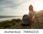 tourist girl with backpack... | Shutterstock . vector #748562215