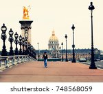 Small photo of FRANCE. PARIS: SEPTEMBER 17, 2009: Alexander III Bridge on the background of the Invalides' House in the historical center of the city. The opening of the Alexander III bridge took place in 1900.