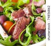 Lean beef and arugula (rocket) salad. Healthy eating. - stock photo