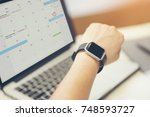 male hand with smart watch on... | Shutterstock . vector #748593727