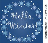 inscription hello  winter in a... | Shutterstock .eps vector #748595215
