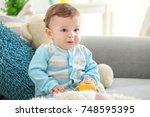 cute baby with bottle of water... | Shutterstock . vector #748595395