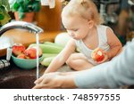 young parents and adorable... | Shutterstock . vector #748597555