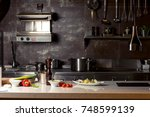 variety of utensils on counter... | Shutterstock . vector #748599139