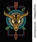 bison skull and crossed arrows. ...   Shutterstock .eps vector #748602931