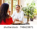 man looking at the woman on a... | Shutterstock . vector #748623871