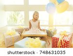 birthday girl sitting with pile ... | Shutterstock . vector #748631035