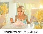 Little Birthday Girl Blowing...