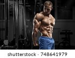 sexy muscular man posing in gym ... | Shutterstock . vector #748641979