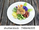 spicy shrimp paste fried rice... | Shutterstock . vector #748646335