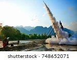 vang vieng  laos   may 2  2015  ... | Shutterstock . vector #748652071