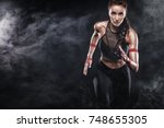 a strong athletic  woman... | Shutterstock . vector #748655305