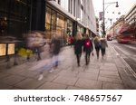 blurred crowd of shoppers...   Shutterstock . vector #748657567