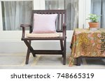 wooden chair standing on the... | Shutterstock . vector #748665319