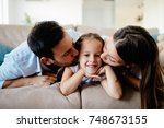 happy family having fun times... | Shutterstock . vector #748673155
